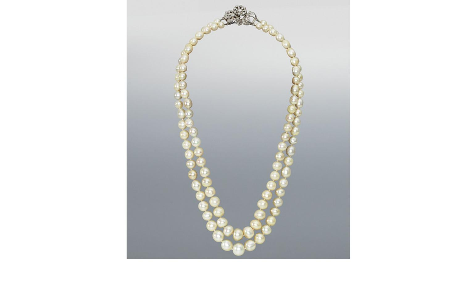 Lot 197. A double-row natural pearl necklace with diamond clasp. Estimate £70,000-90,000. SOLD FOR £253,250.