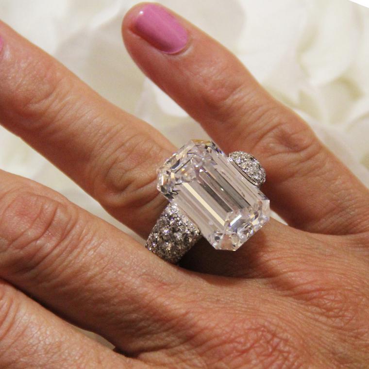 22.35-carat emerald-cut diamond ring with emeralds