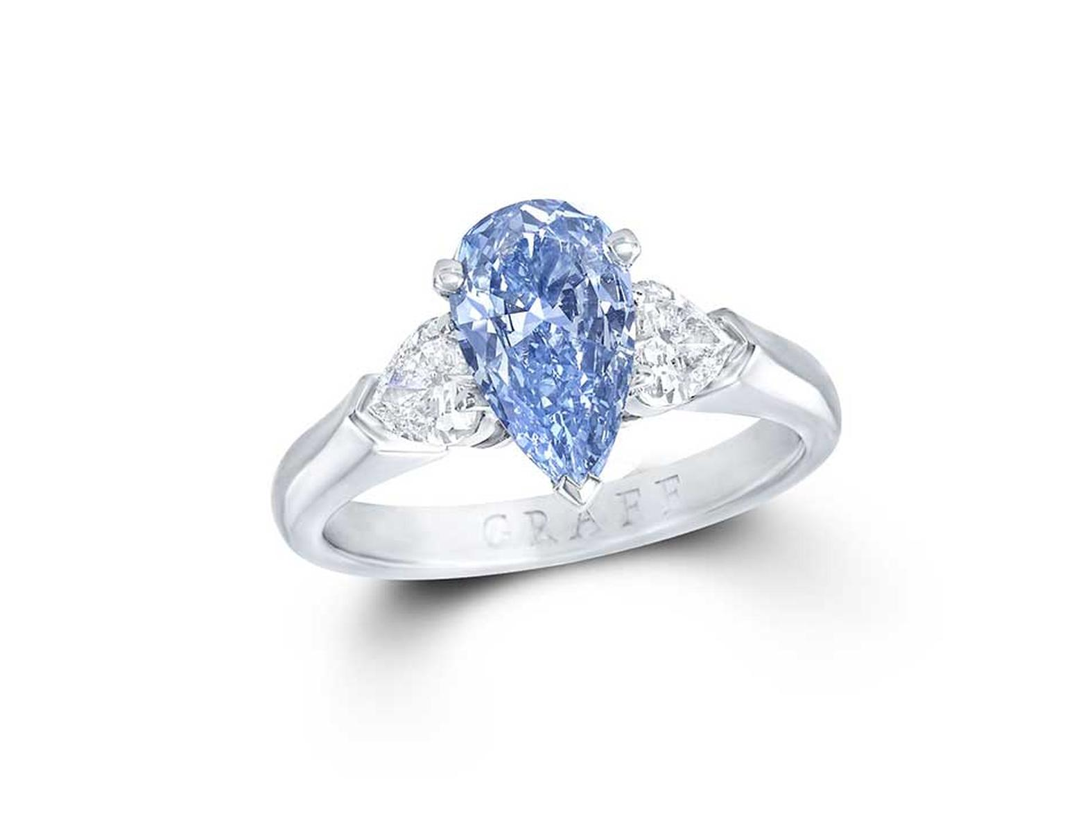 Graff 1 04ct Internally Flawless Blue Diamond Engagement Ring Flanked By Two Pear Shaped White