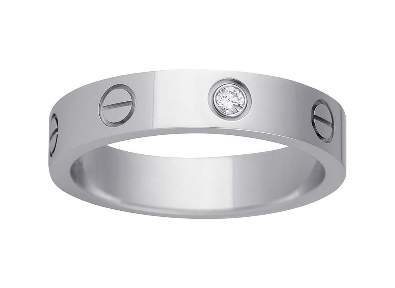 With Its Trademark Motif Cartier S Love Platinum Wedding Band Set A Single
